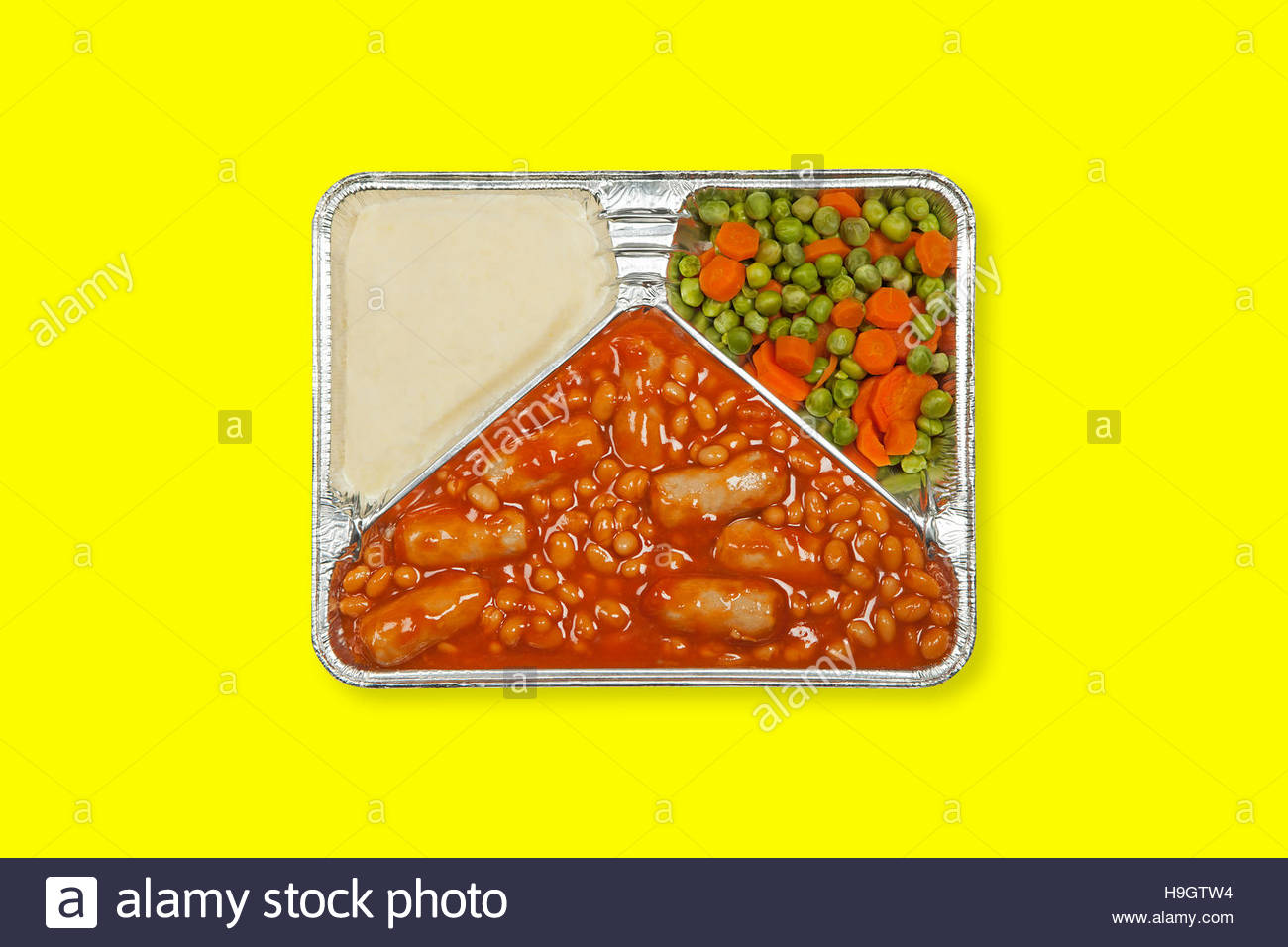 TV dinner tray vintage retro meal aluminum food dish on plain background - Stock Image