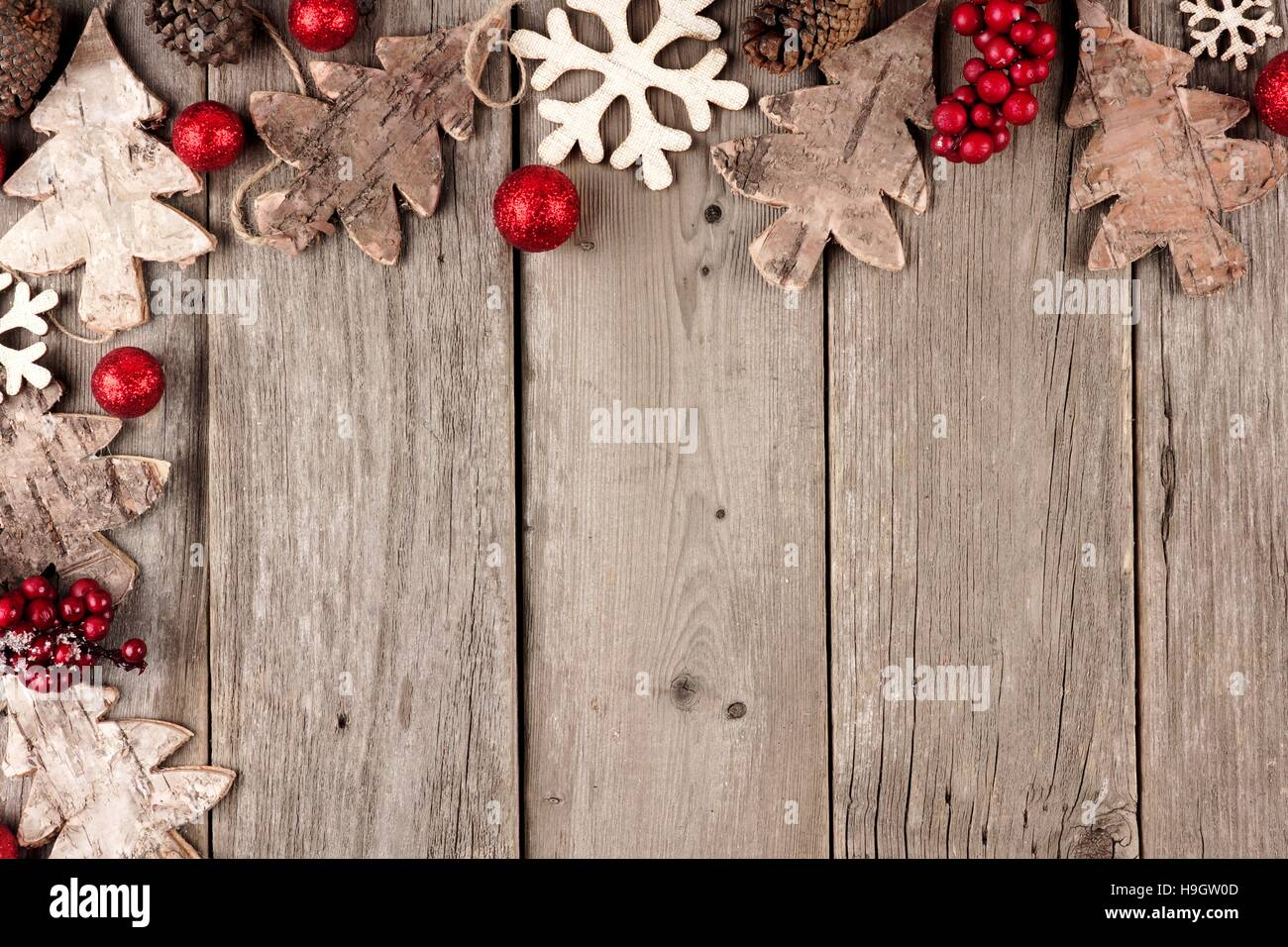 Rustic Christmas Corner Border With Wood Ornaments And Berries On An Aged Background