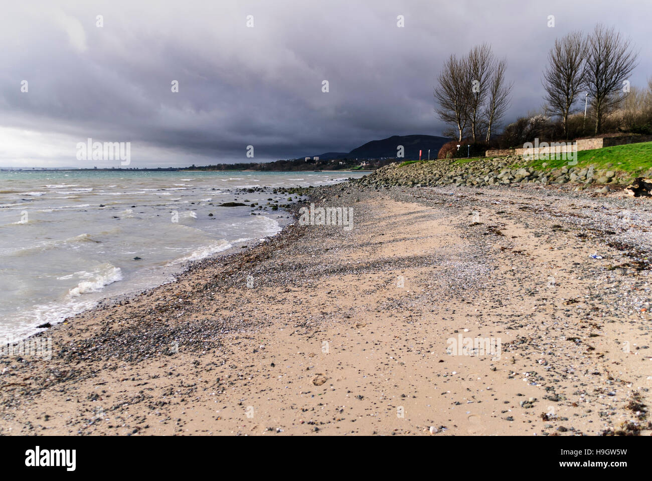 A storm approaches a beach. - Stock Image
