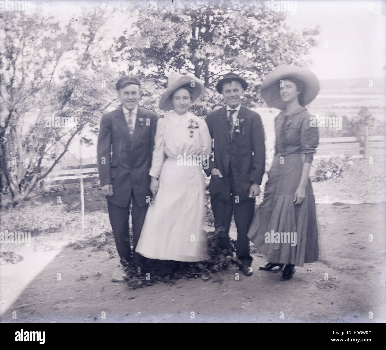 Antique c1900 photograph, two couples in late Victorian dress. Long shutter exposure created slight motion blur. Stock Photo