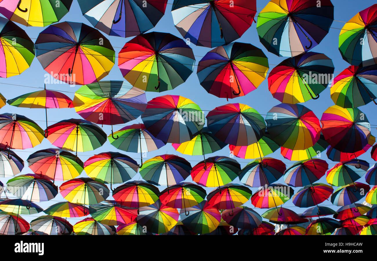 Multi-colored umbrellas in the sky.Umbrellas rainbow colors - Stock Image