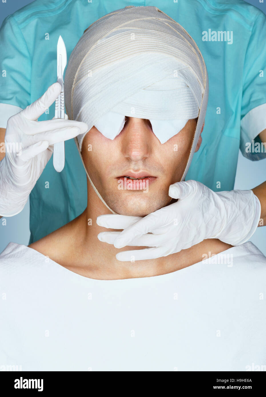 Patient with medical Bandage on his Eyes after cosmetic operation. Close up of bandaged face before Plastic Surgery. - Stock Image