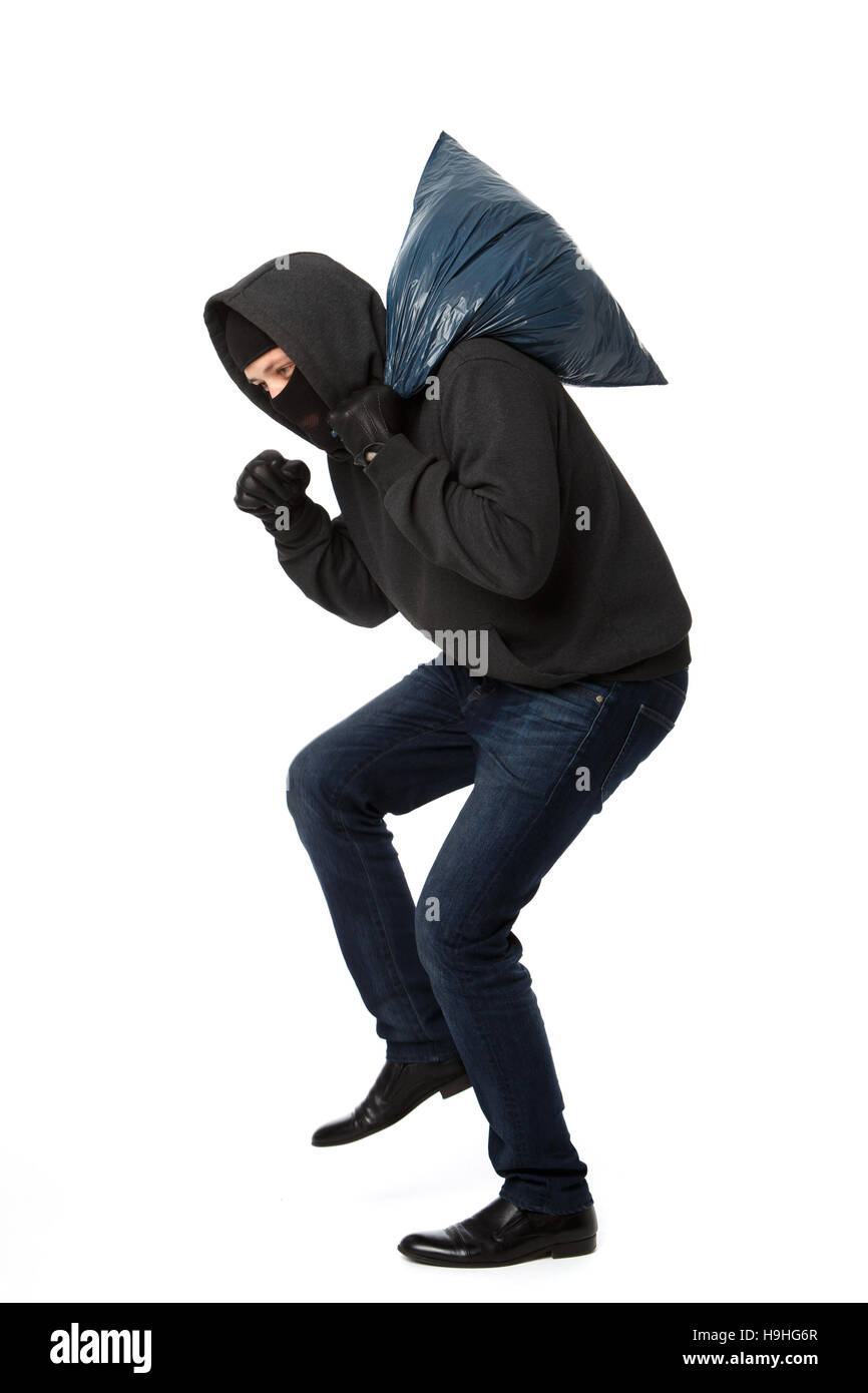 Robber steals with large bag - Stock Image