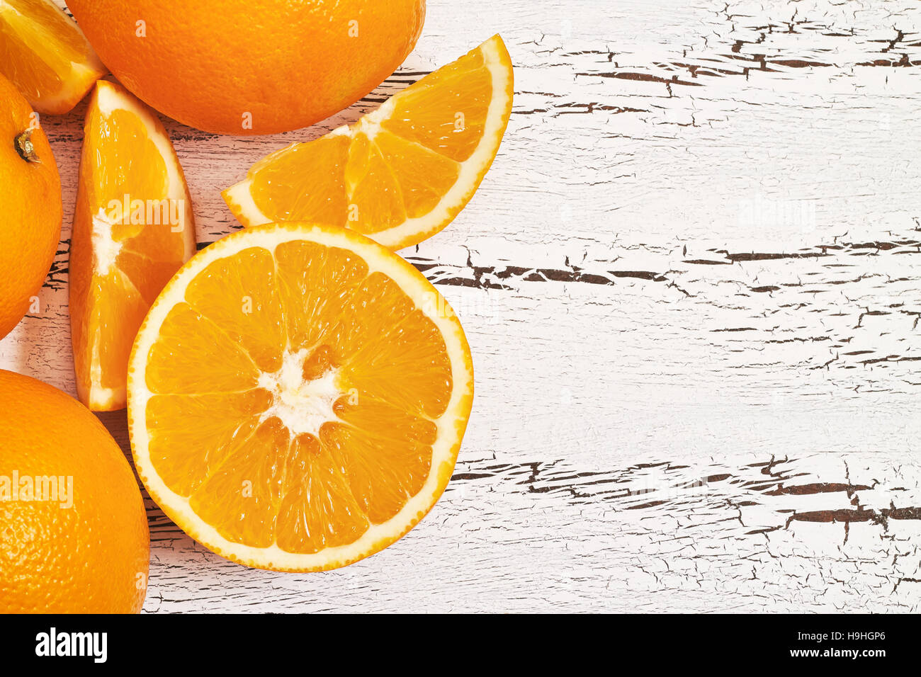 Oranges on white rustic wooden background. Top view with copy space - Stock Image