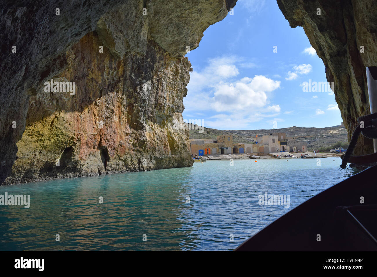Eastern end of the natural tunnel leading from the inland lake to the Mediterranean sea at Dwejra, Gozo - Stock Image