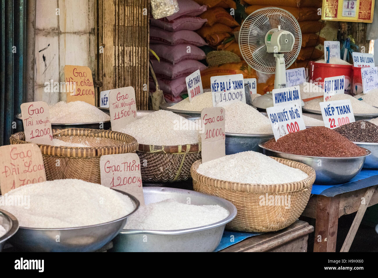 different sorts of rice for sale on a local market in Vinh Long, Mekong Delta, Vietnam, Asia - Stock Image