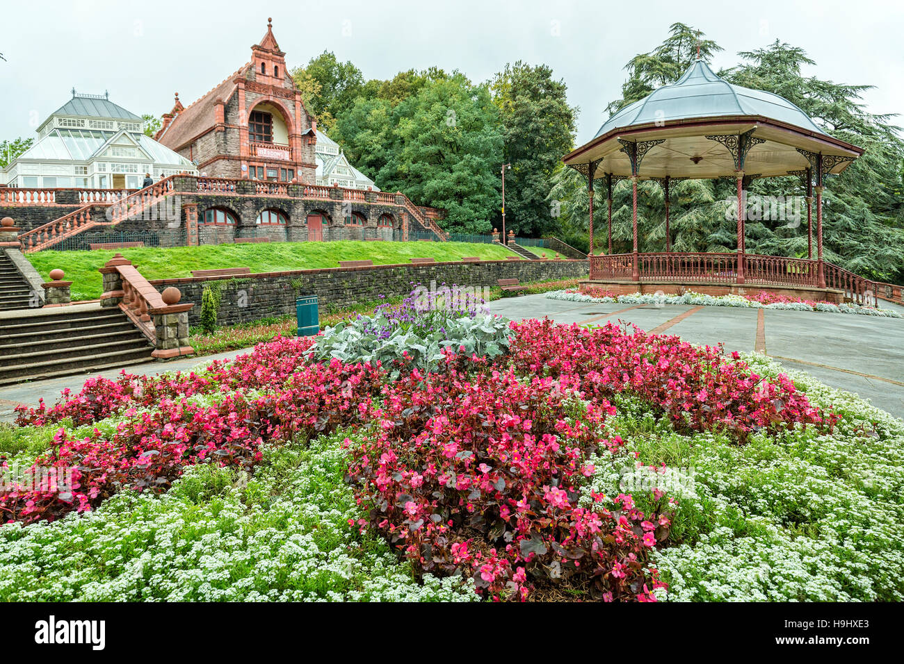 Bandstand and flowerbed with begonias in Belle Vue public park, Newport, Gwent, UK - Stock Image