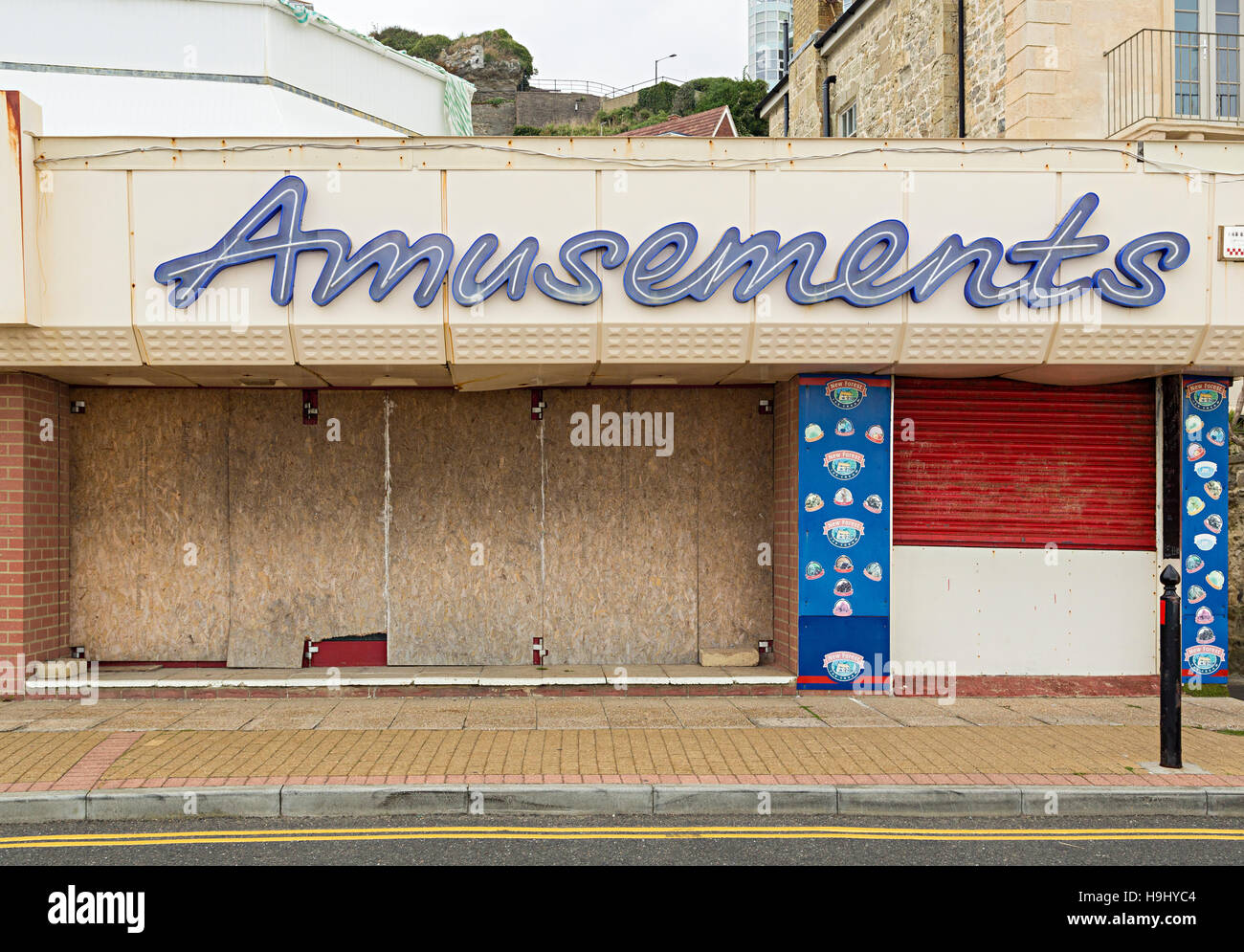 Closed and boarded up amusements arcade on seafront, Ventnor, Isle of Wight, UK - Stock Image