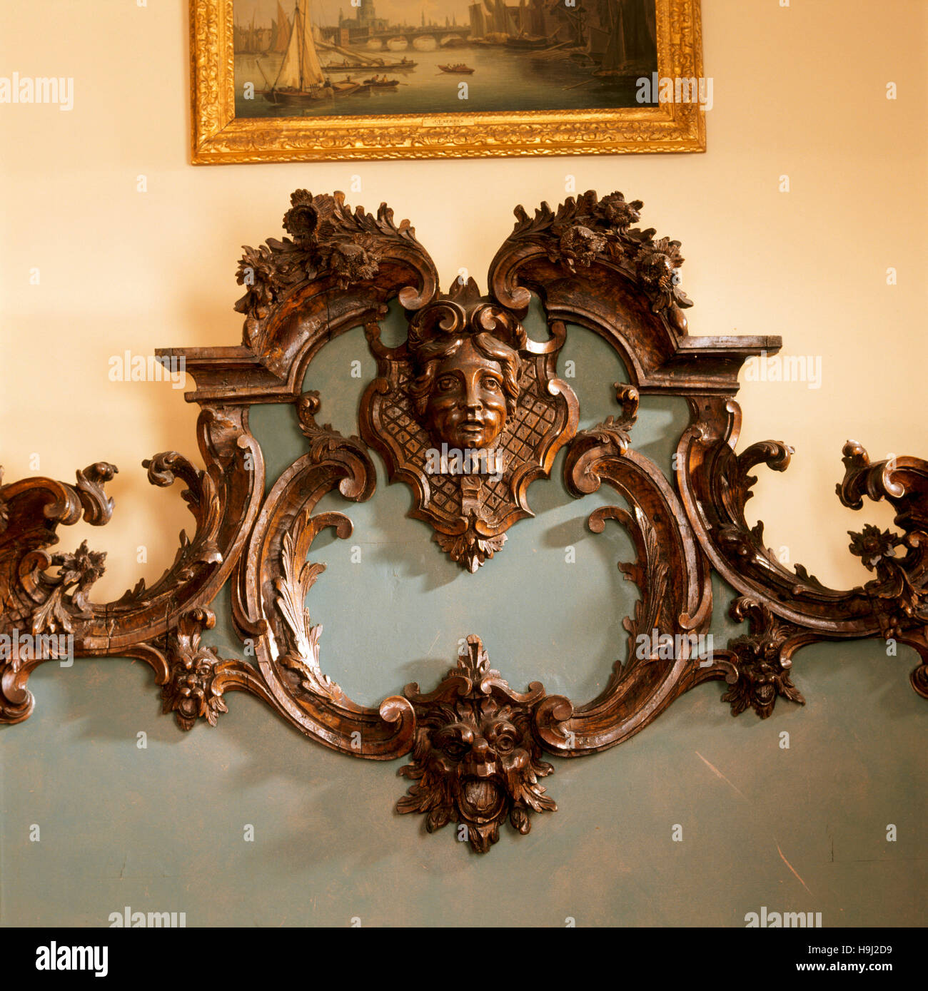 The carved pine bedhead in the mid th century rococo style of