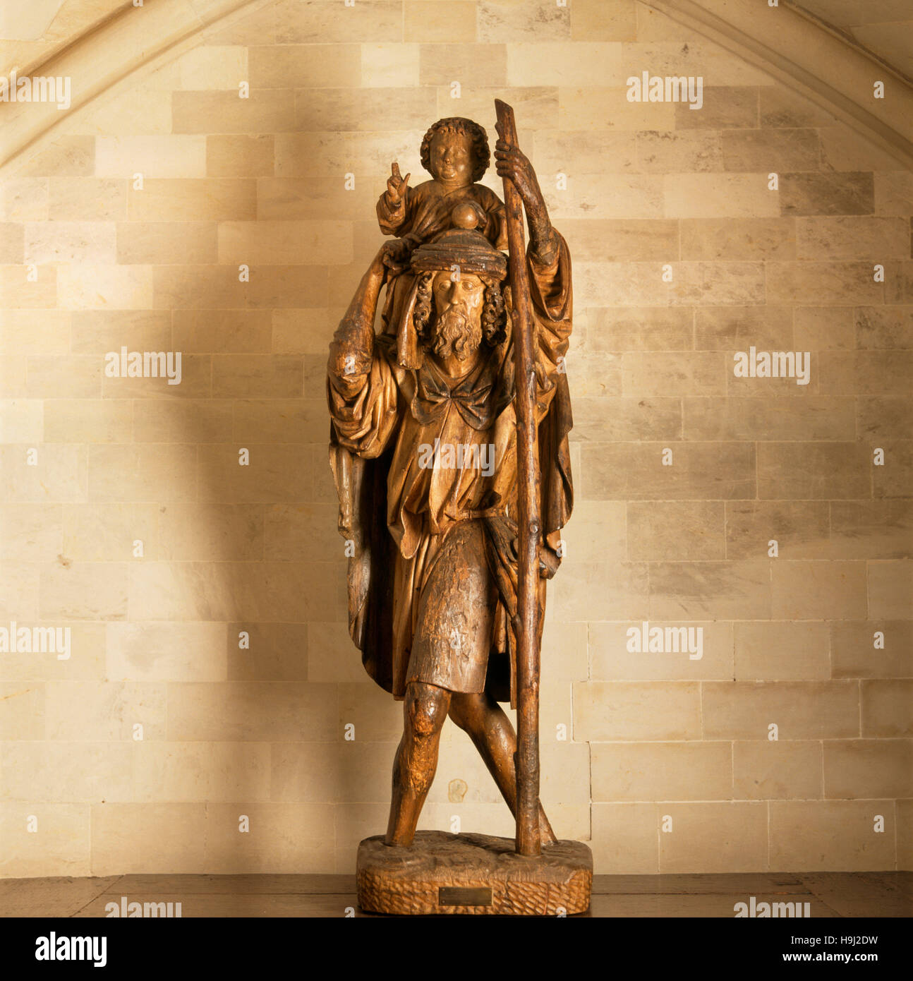 The Dining Room, close-up view of 15th century limewood statue of St Christopher carrying the infant Christ attributed - Stock Image