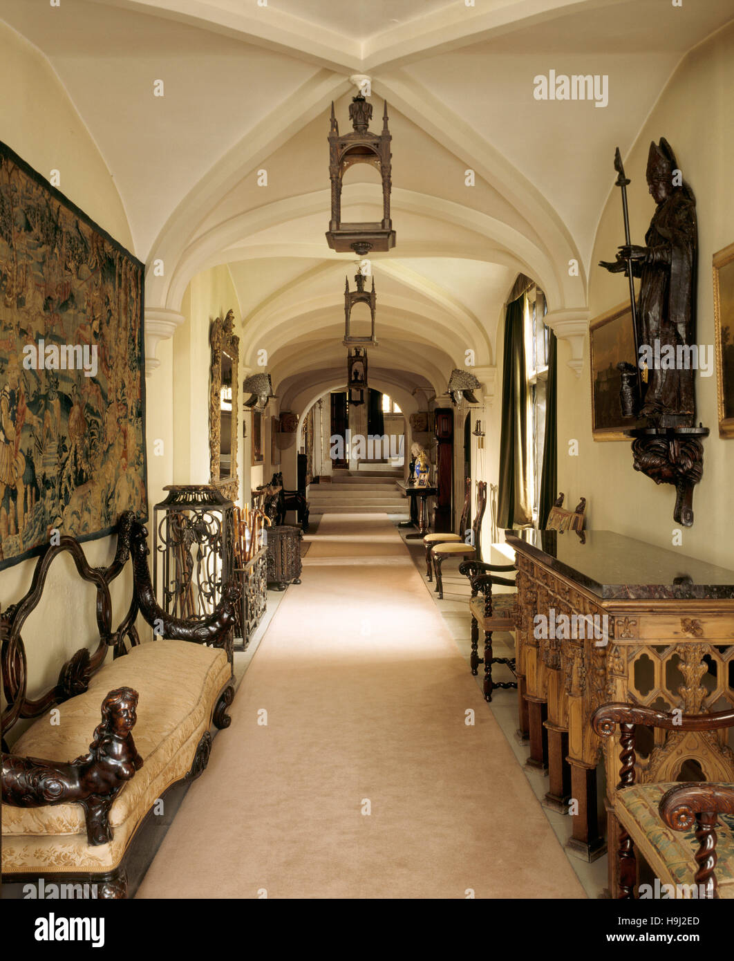The Long Gallery at Anglesey Abbey - view from the Porch end towards the staircase including the Portuguese hall - Stock Image