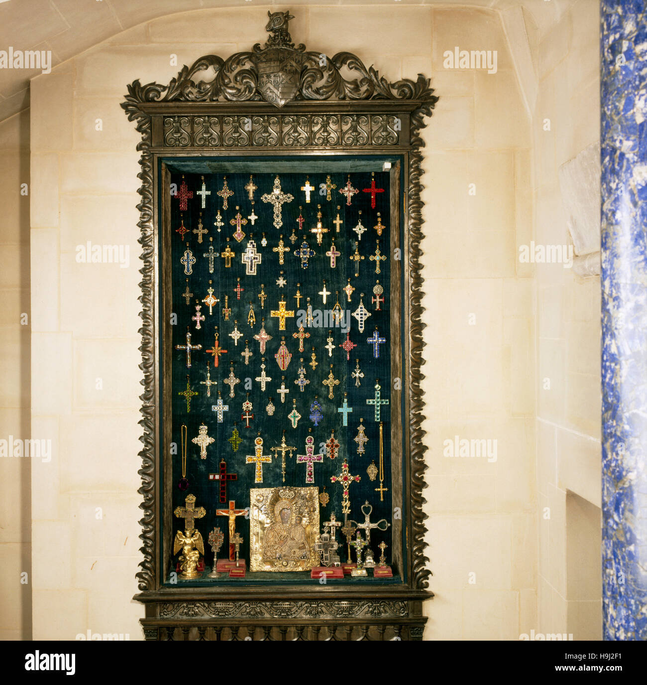 Renaissance cabinet under the stairs in the Tapestry Hall with a collection of mainly C19th crosses in gold, silver - Stock Image
