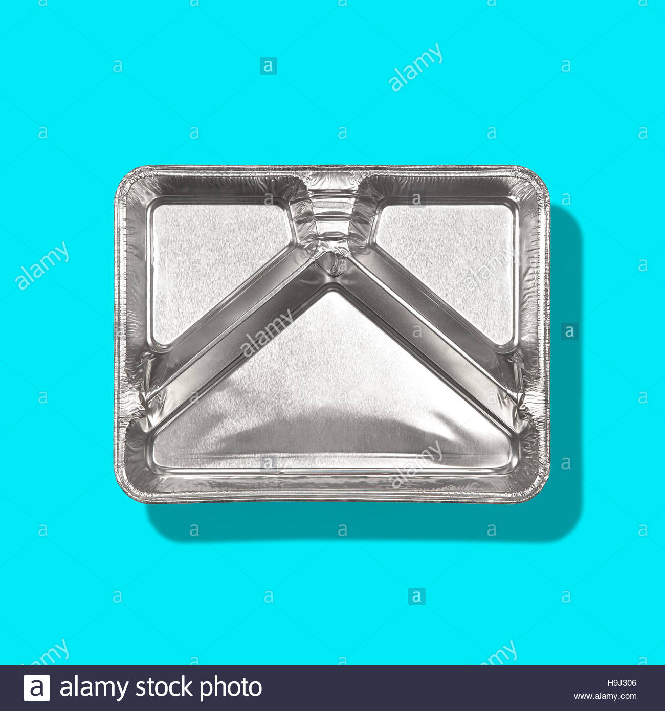 TV dinner tray vintage retro meal aluminum food dish on plain background Stock Photo