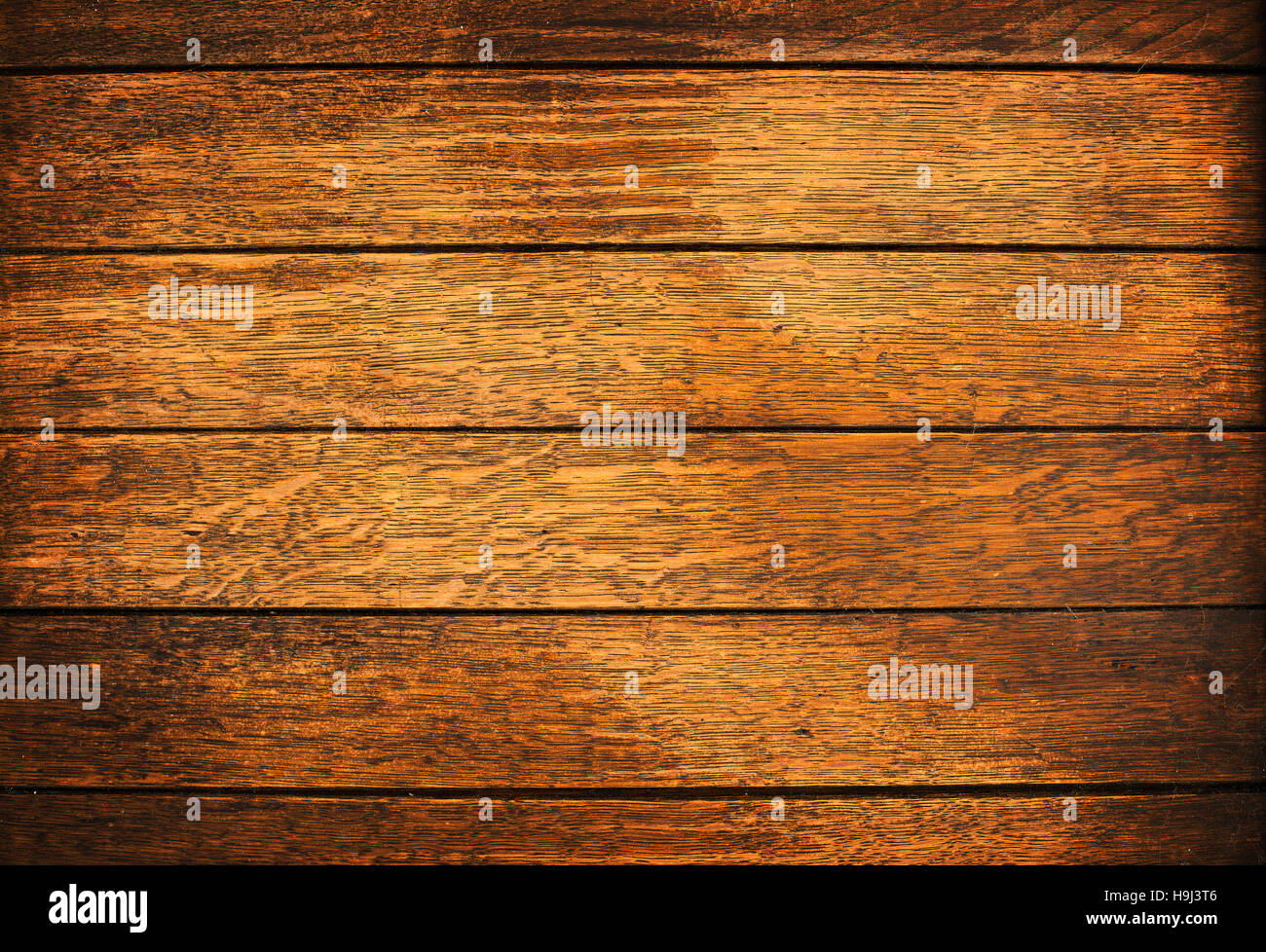 Wood plank brown texture background close up - Stock Image