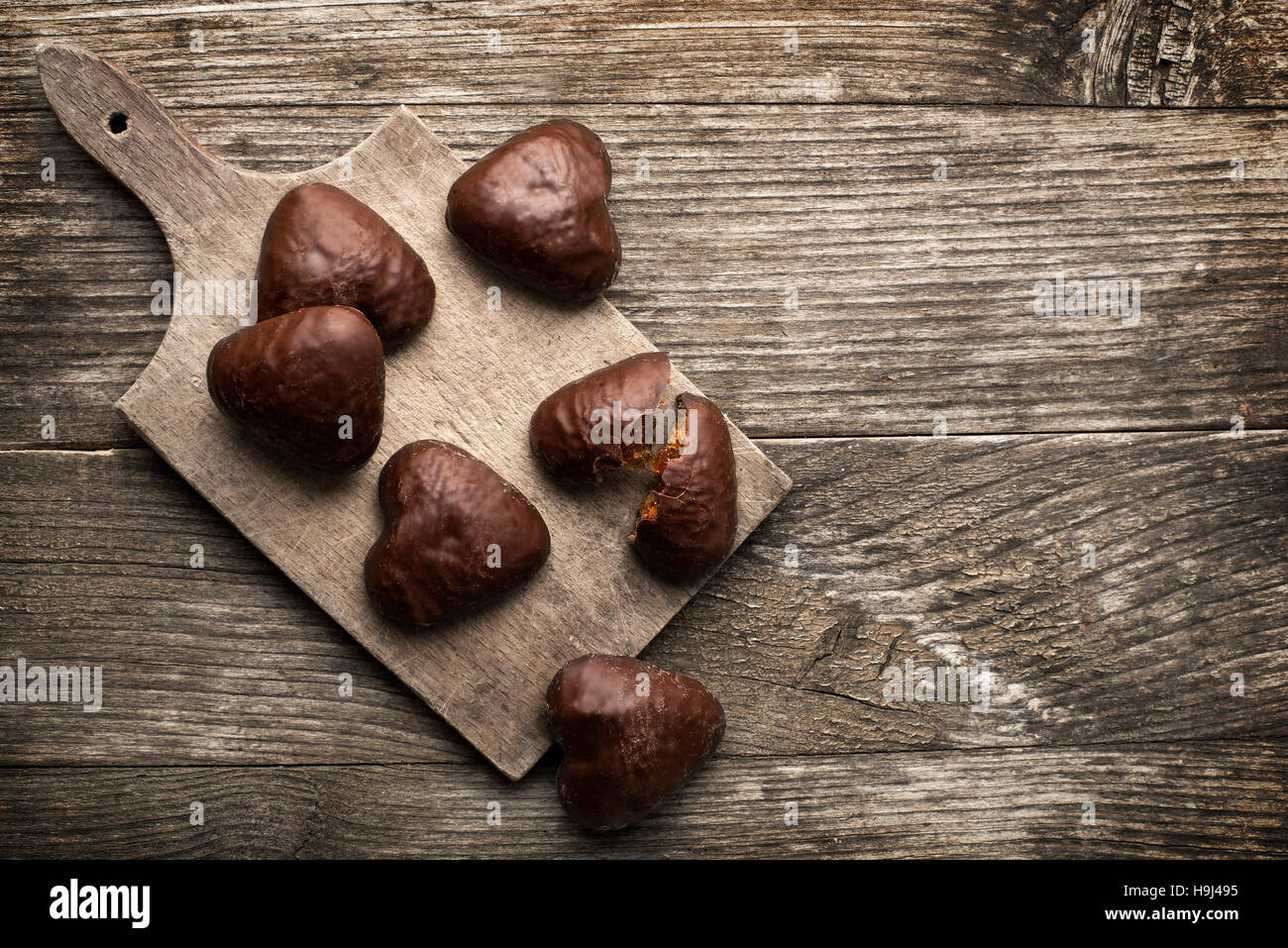 heart shaped chocolate cookies on a plate - Stock Image