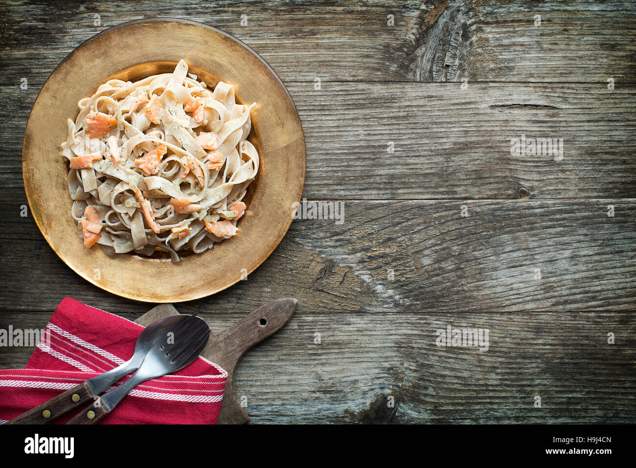 Fresh pasta with smoked salmon in the sauce - Stock Image