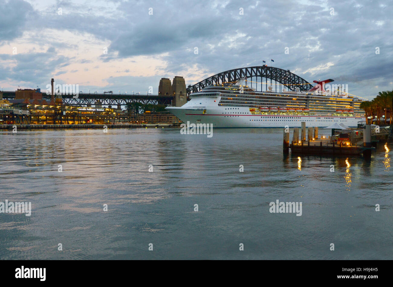 SYDNEY - OCT 19 2016:Cruise ship mooring at the Overseas Passenger Terminal   in Sydney Cove at dusk with the Sydney - Stock Image