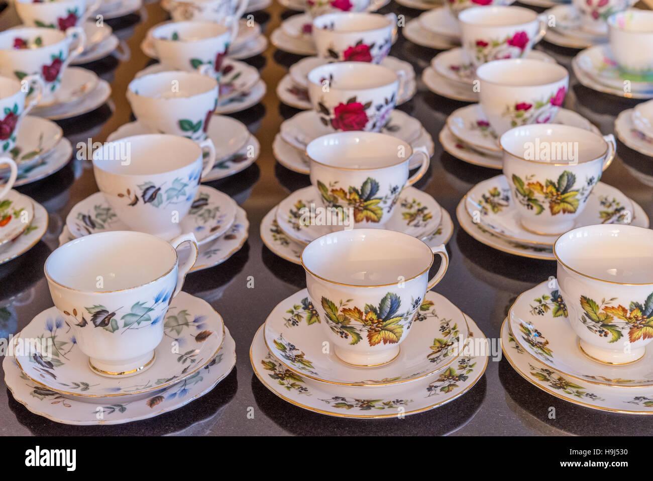 A collection of fine bone china tea cups and saucers. - Stock Image