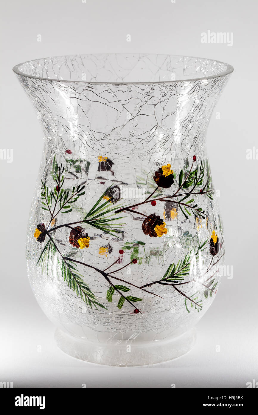 branches and acorns on cracked glass vase - Stock Image