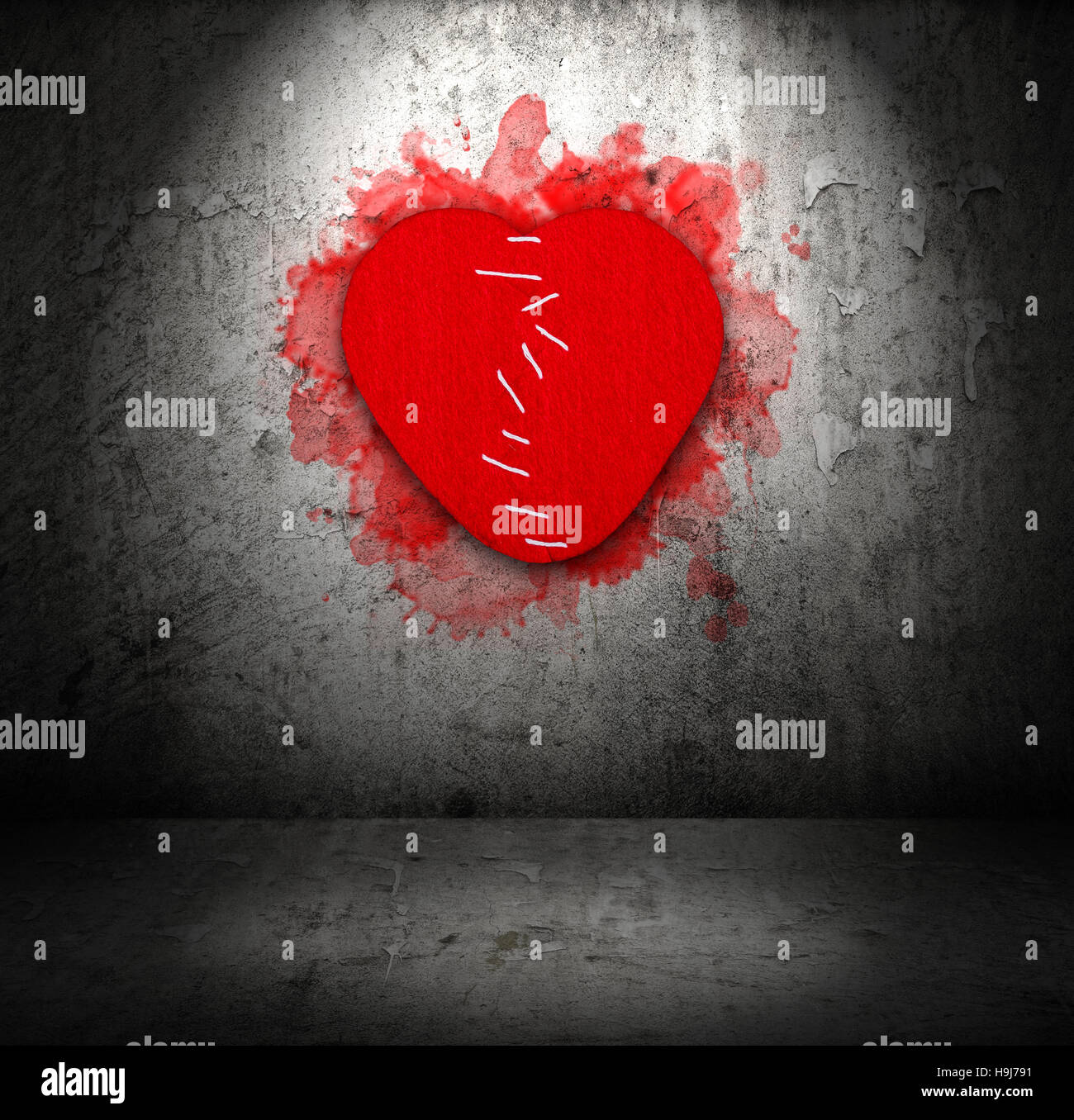 Stitched felt broken heart - Stock Image