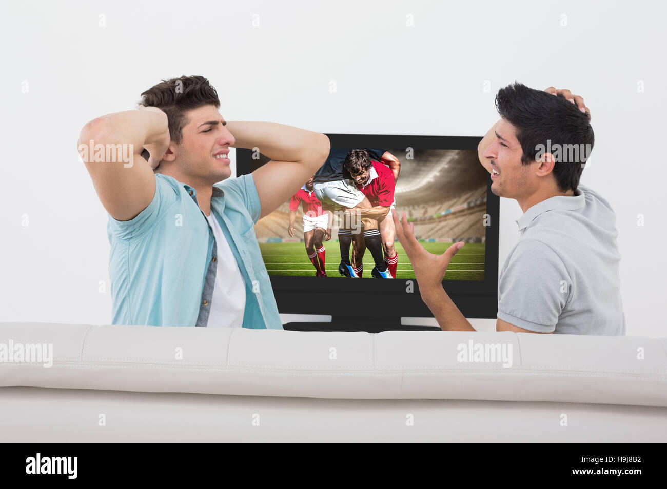 Composite image of disappointed soccer fans watching tv - Stock Image