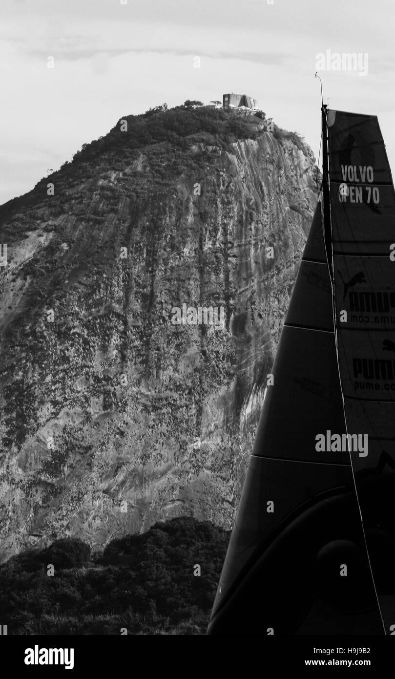 Sugar Loaf mountain and large sail on racing yacht - Stock Image