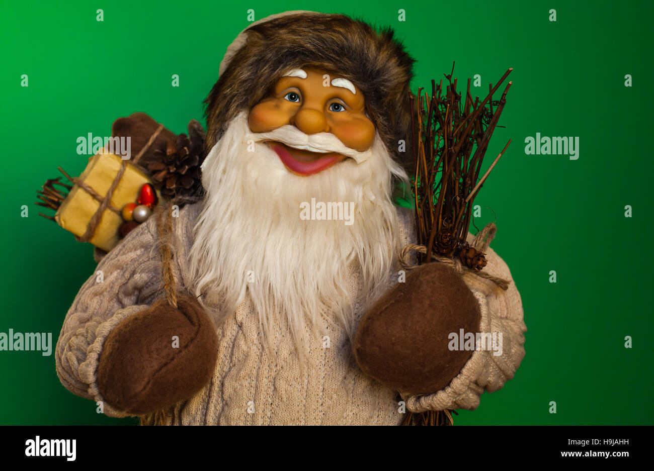 Santa Claus upper body close up with green background. - Stock Image