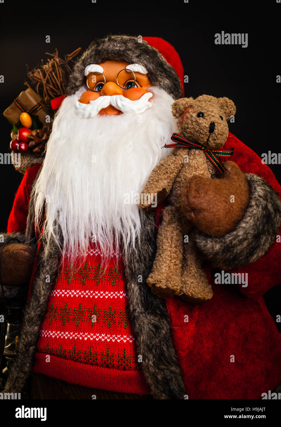 Santa Claus upper body close up with black background. - Stock Image