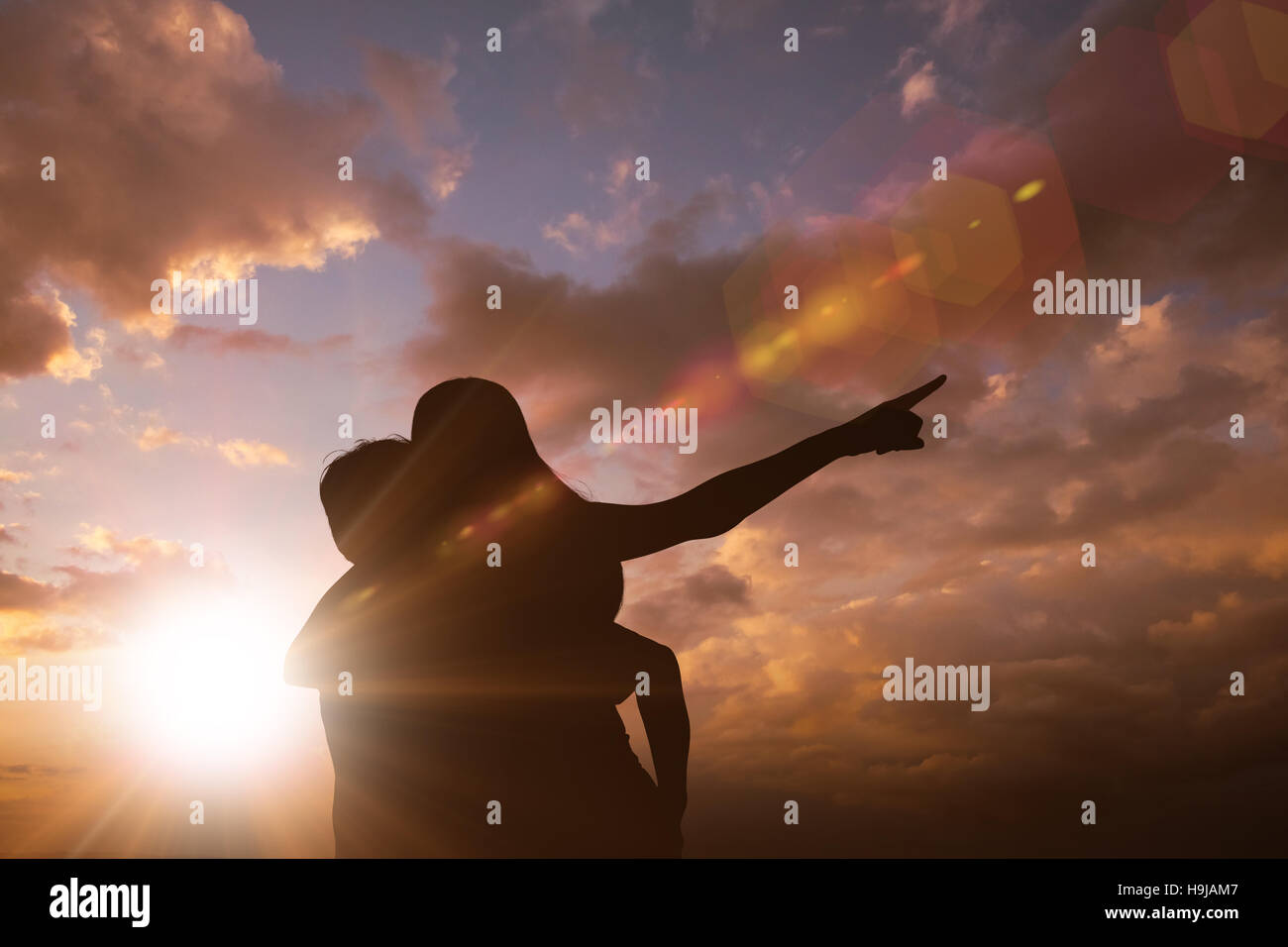 Composite image of happy casual man giving pretty girlfriend piggy back - Stock Image