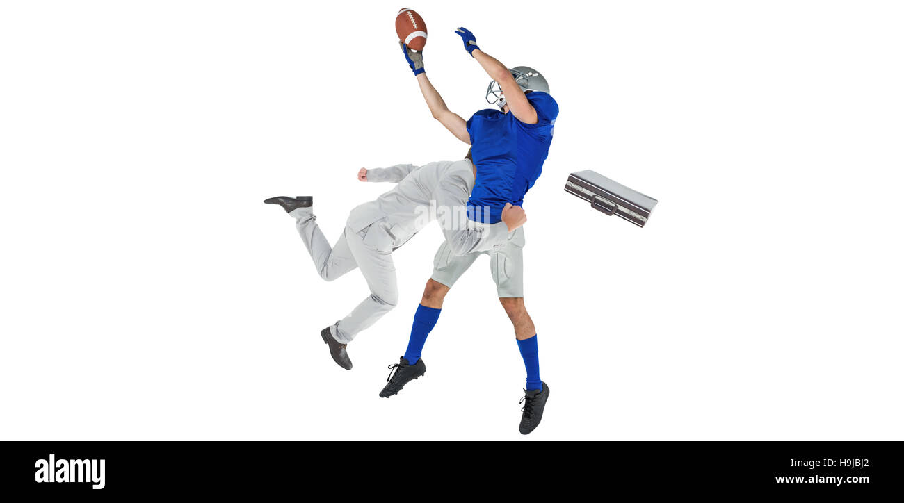 Composite image of businessman tackling a football player - Stock Image