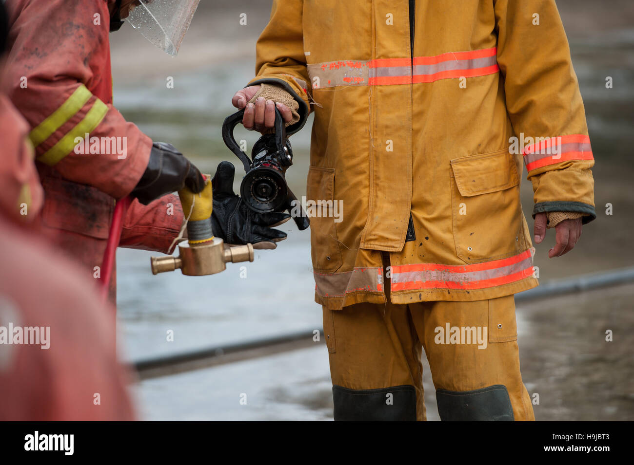 Firefighters carry host connection - Stock Image