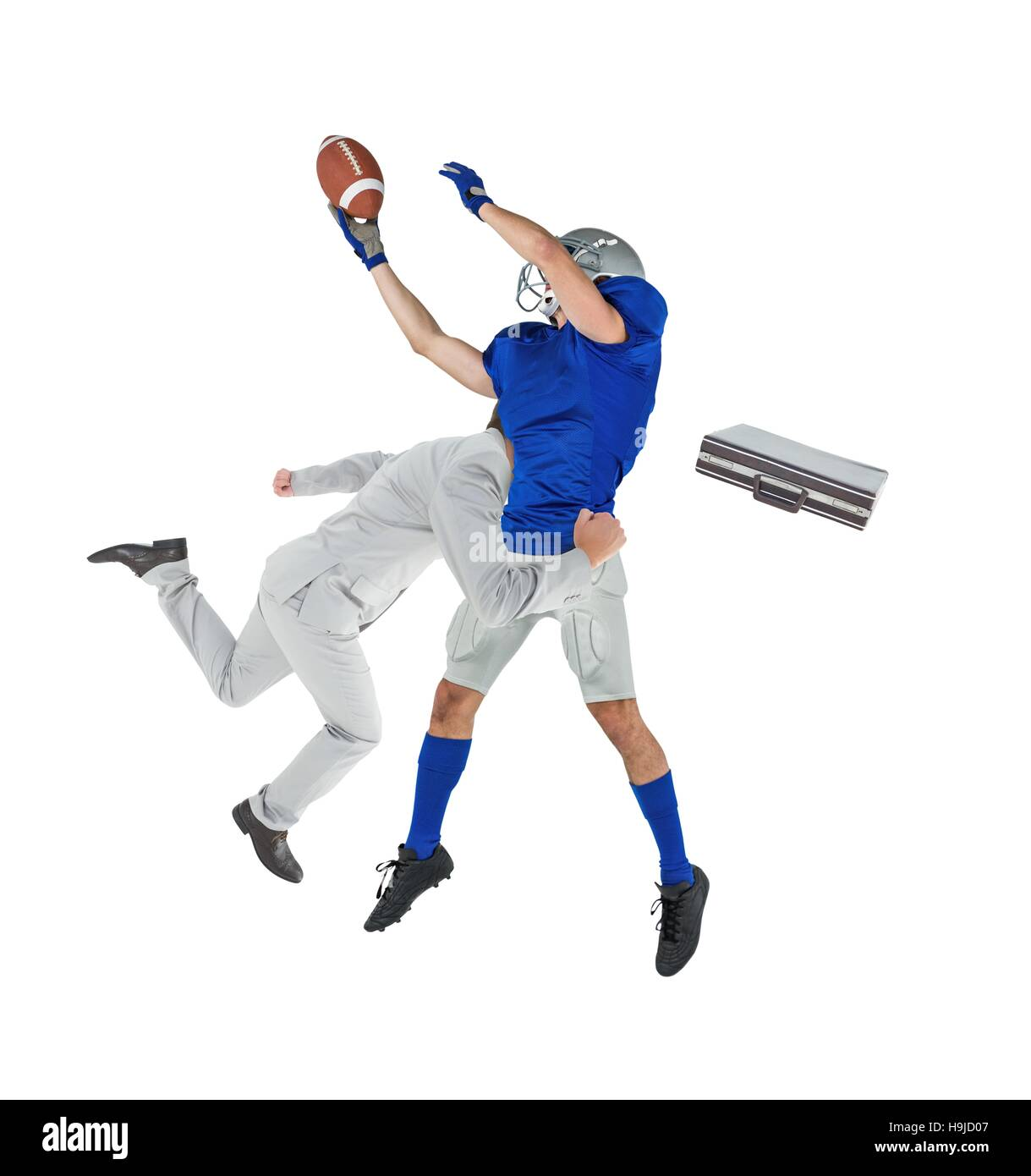 Businessman tackling a football player - Stock Image