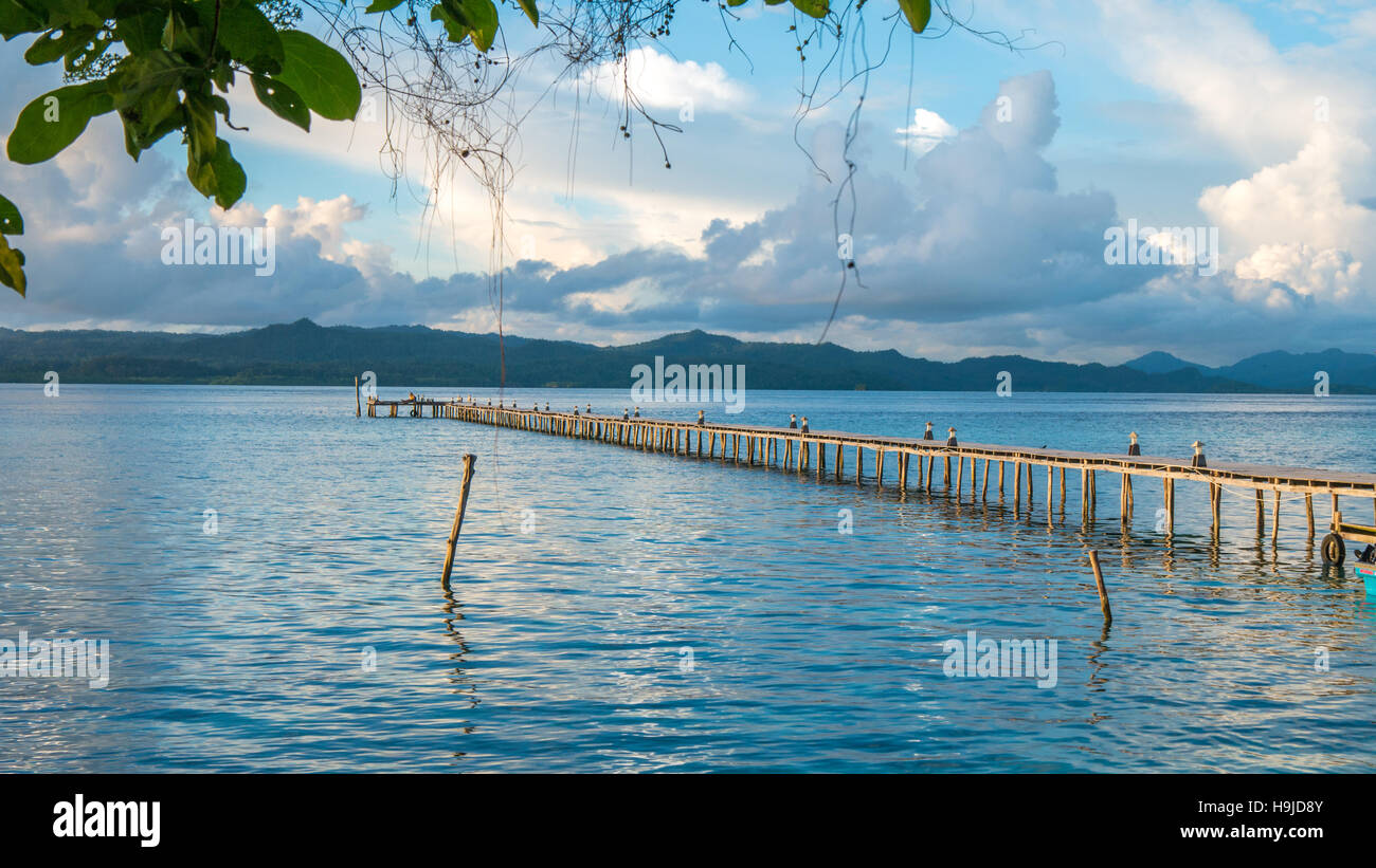 Pier of Dive Station - Kri Island. Clound above Gam in Background. Raja Ampat, Indonesia, West Papua - Stock Image
