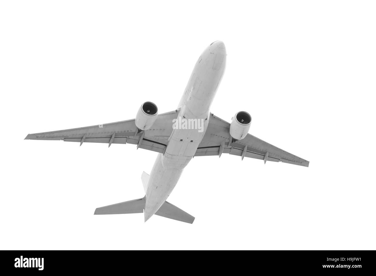 Real jet passenger aircraft taking off isolated on white background with clipping path - Stock Image