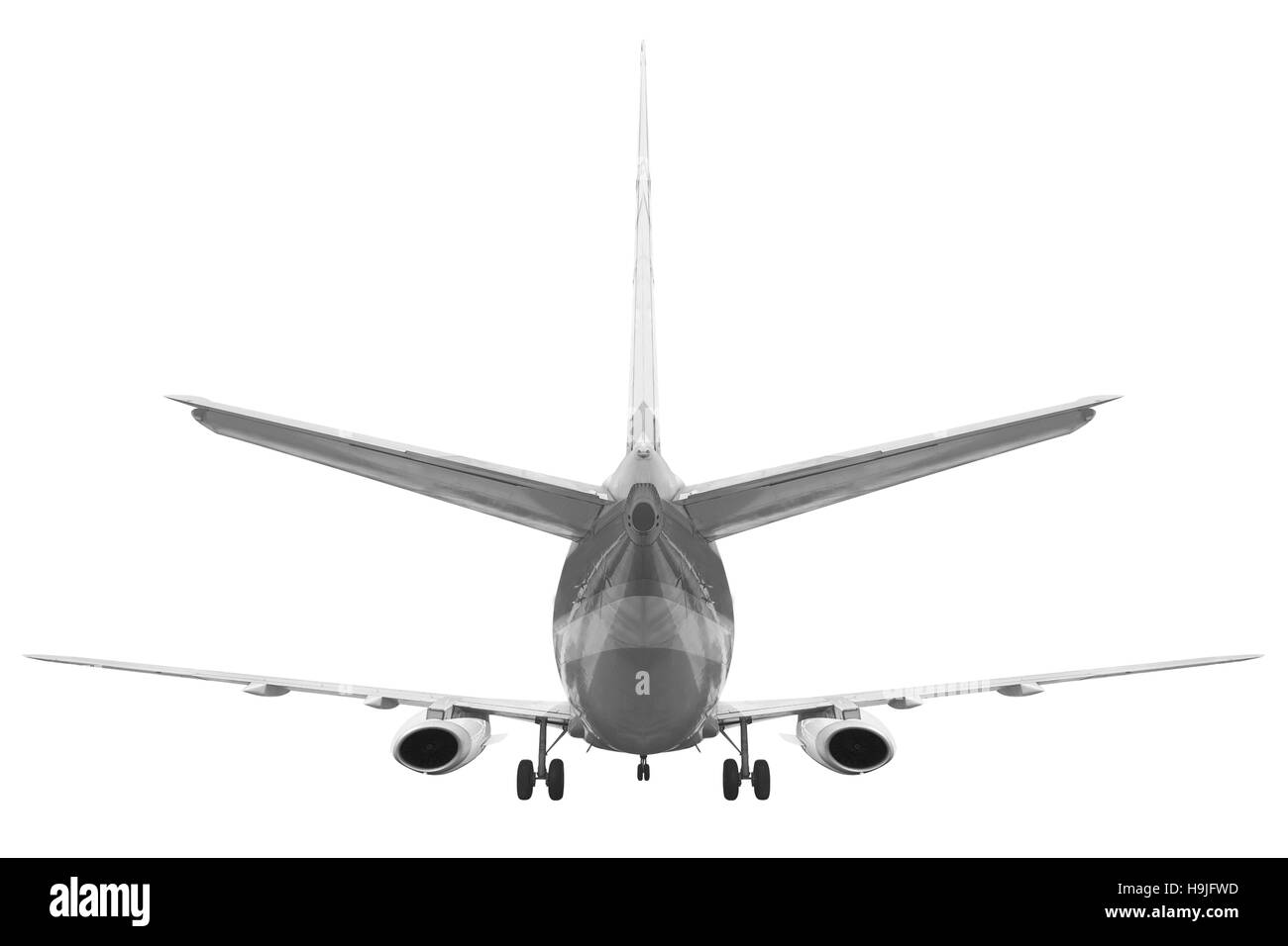 Rear view Passenger aircraft isolated on white background with clipping path - Stock Image