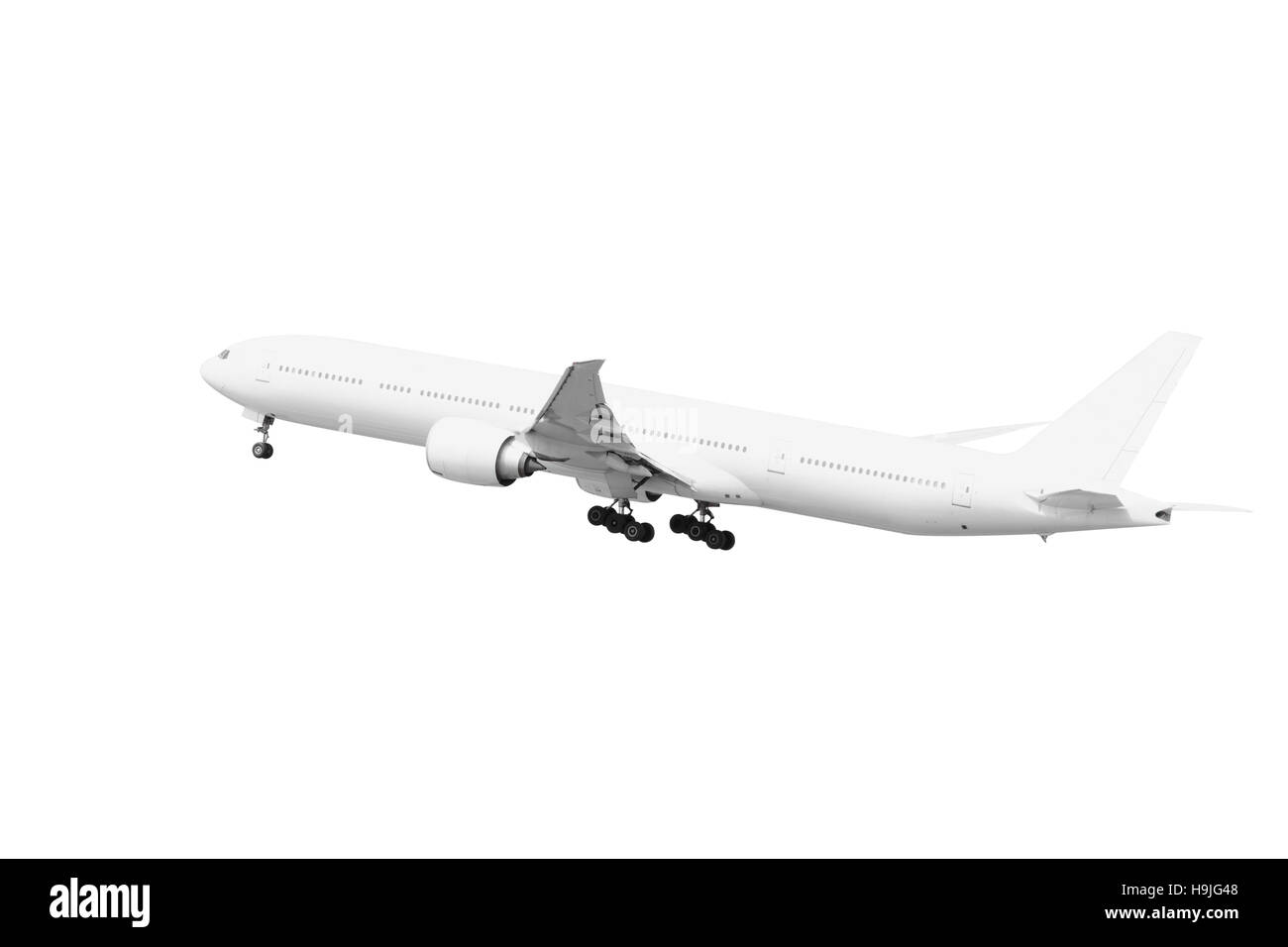 White Passenger aircraft taking off isolated on white background with clipping path - Stock Image
