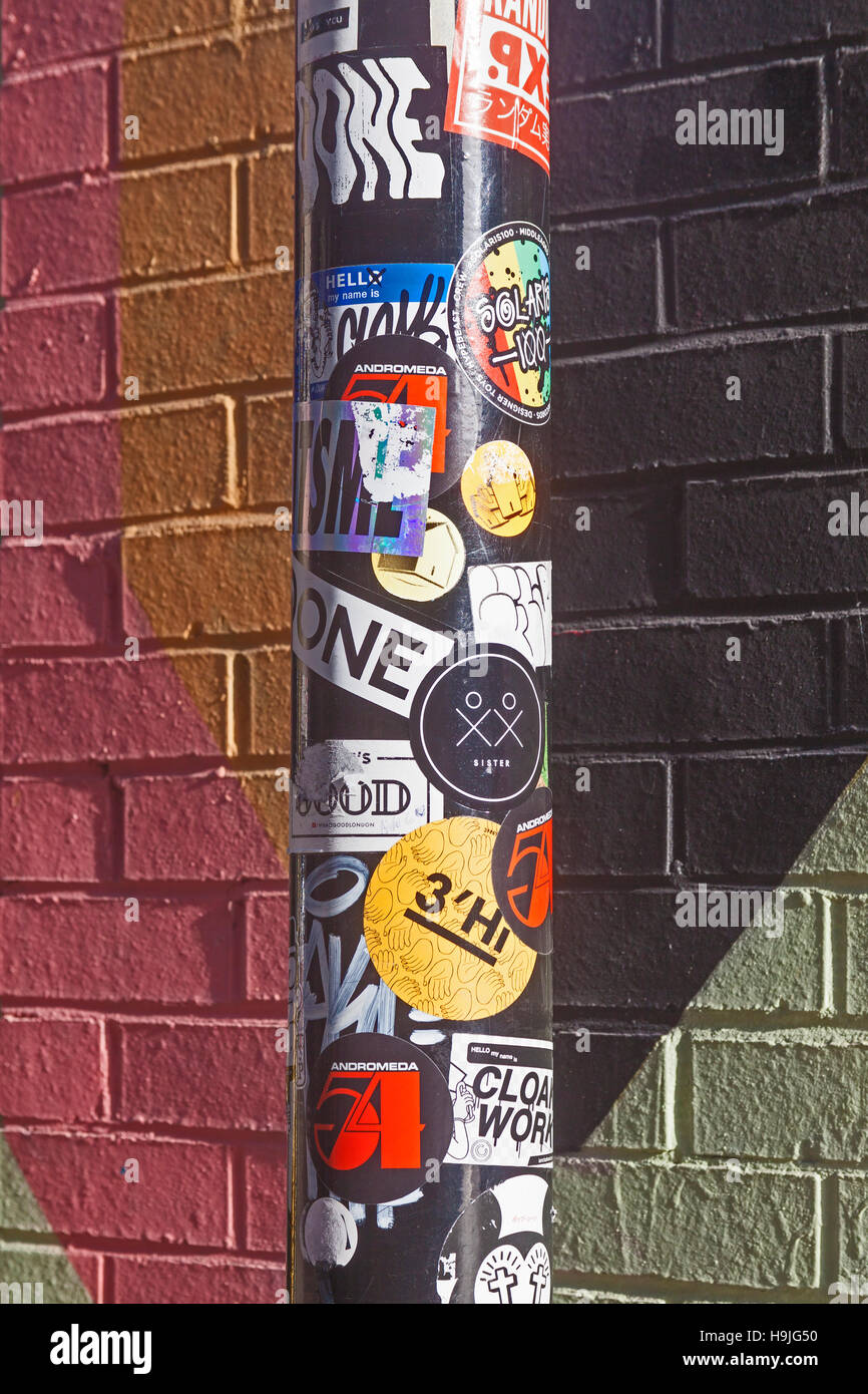 London, Shoreditch   Fly-posting on a signpost - Stock Image