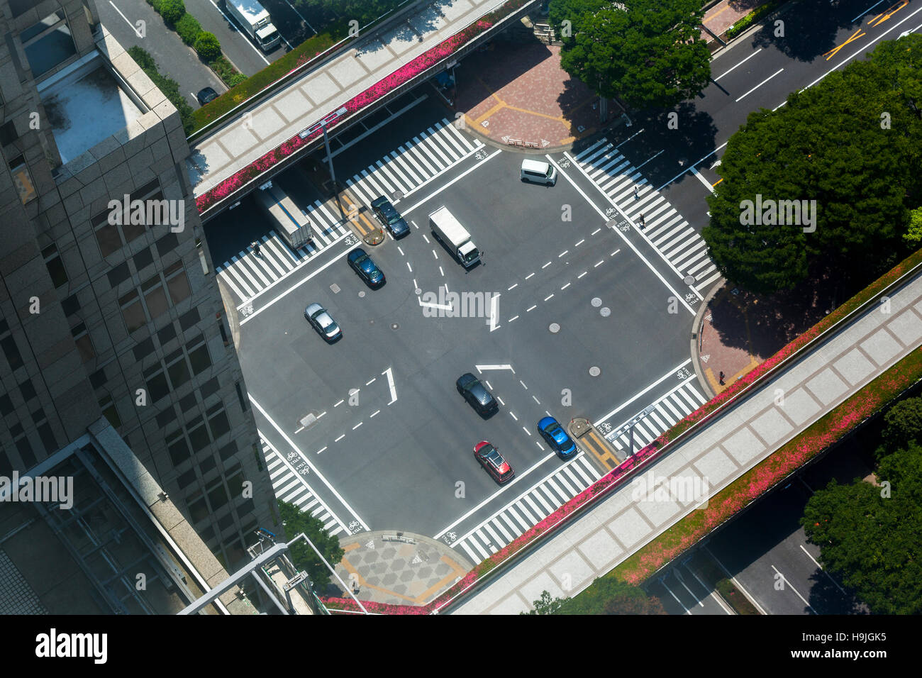 A road intersection in Tokyo, Japan viewed from a skyscraper window. - Stock Image