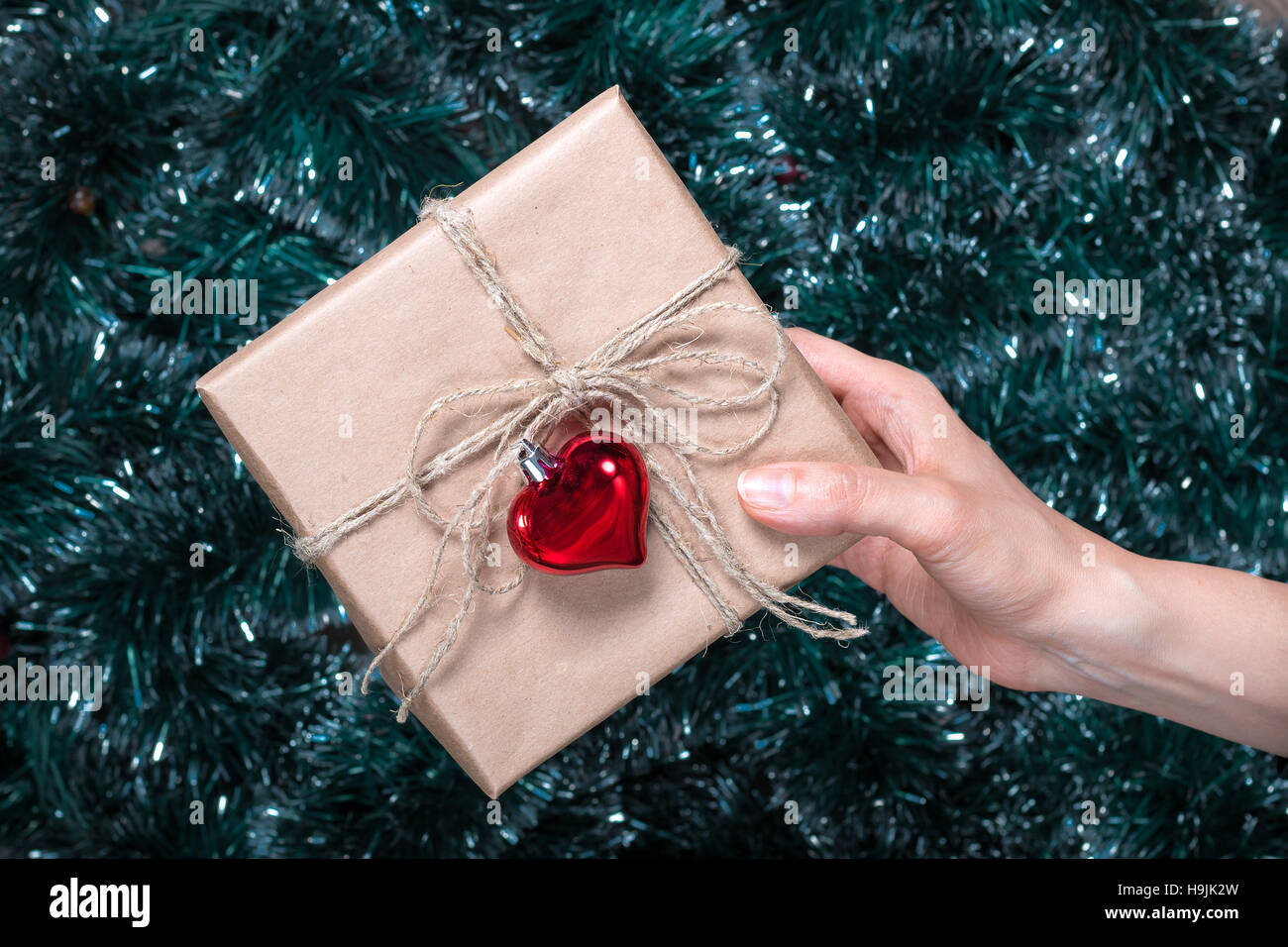 packaging holiday giftsyoung girl gives a christmas gift with decorations top view