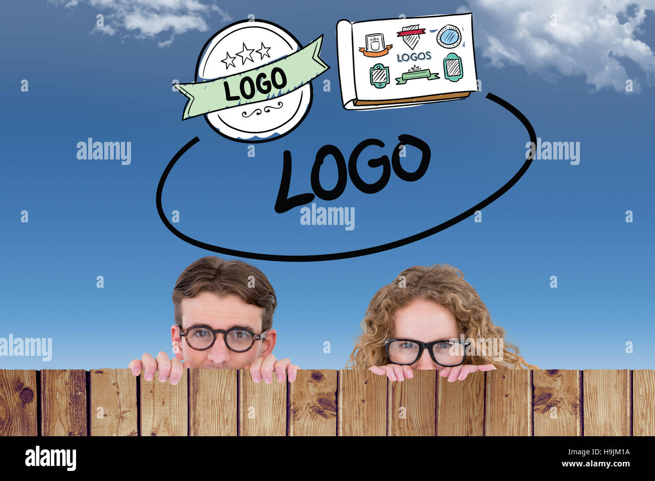 Composite image of geeky hipster couple holding poster - Stock Image