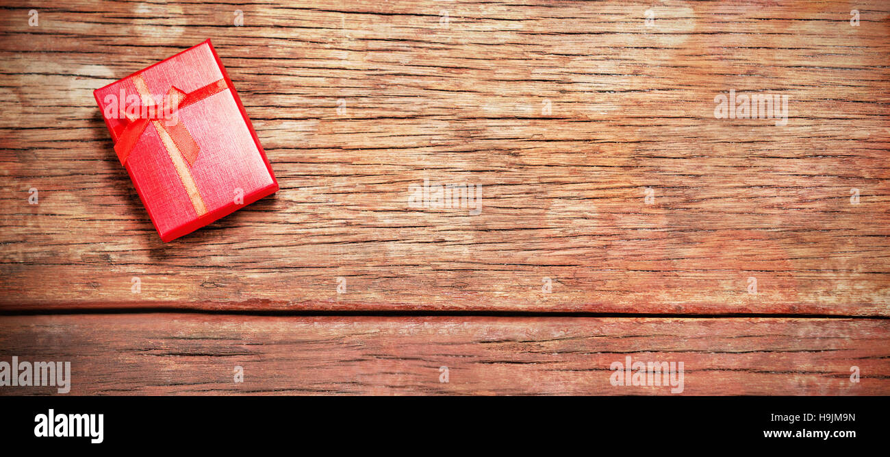 Christmas gift on wooden table - Stock Image