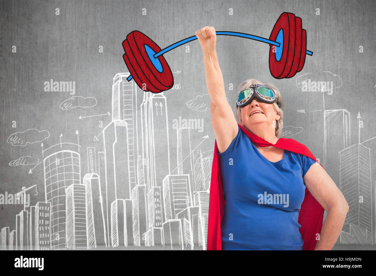 Composite image of senior woman disguise as superhero with hand raised - Stock Image