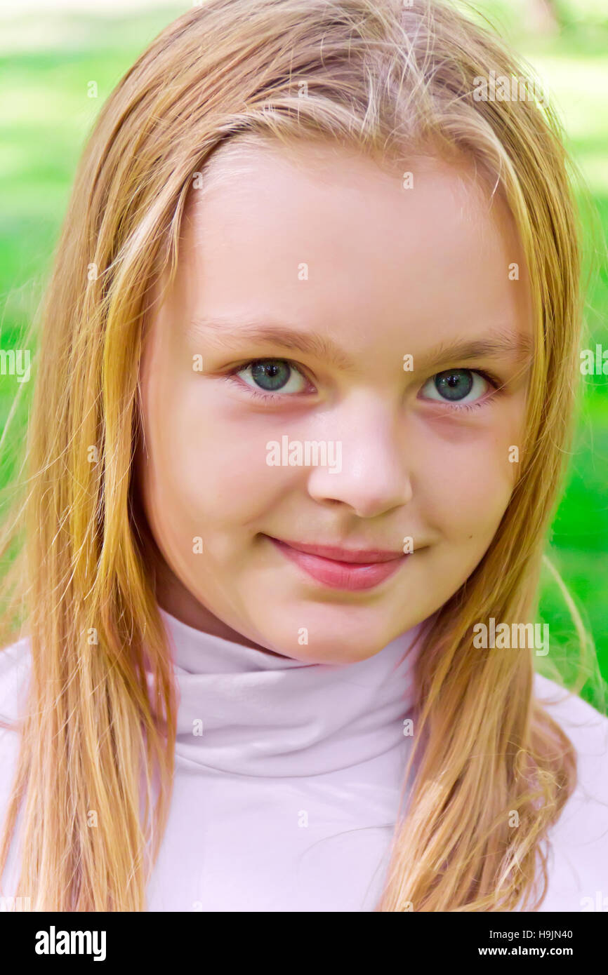 Photo of cute girl with big blue eyes Stock Photo