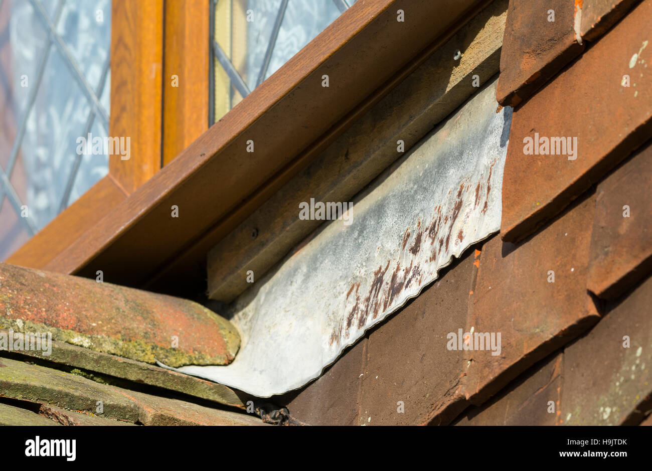 Lead flashing under a PVC window. - Stock Image