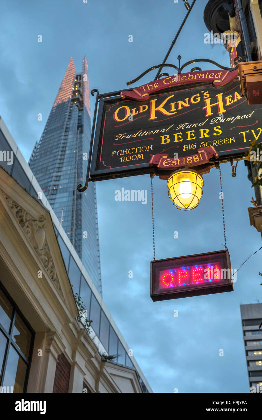 Old King's head Traditional English pub sign with the Shard skyscraper in the background, Borough High Street,London,England - Stock Image