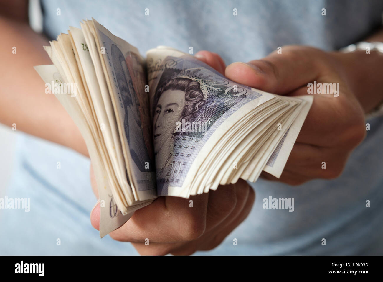 Woman counts British Pound Sterling - Stock Image