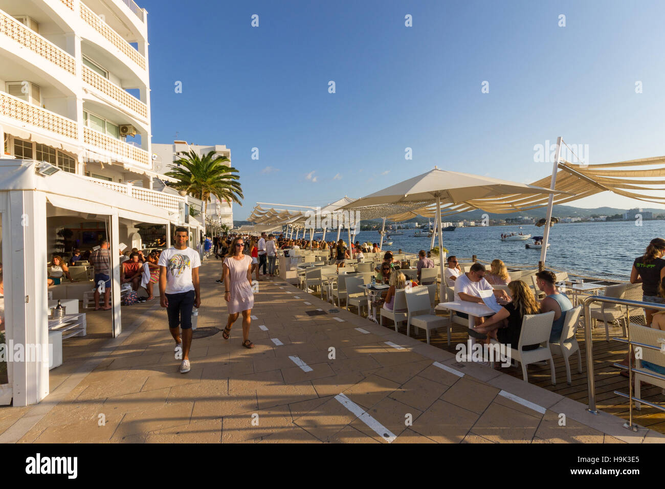 Spain, Balearic Islands, Ibiza, Sant Antoni de Portmany, people at Cafè del Mar Stock Photo