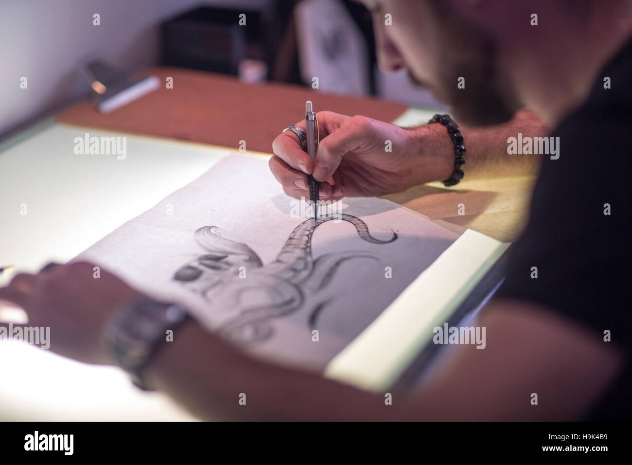 Graphic artist sketching - Stock Image