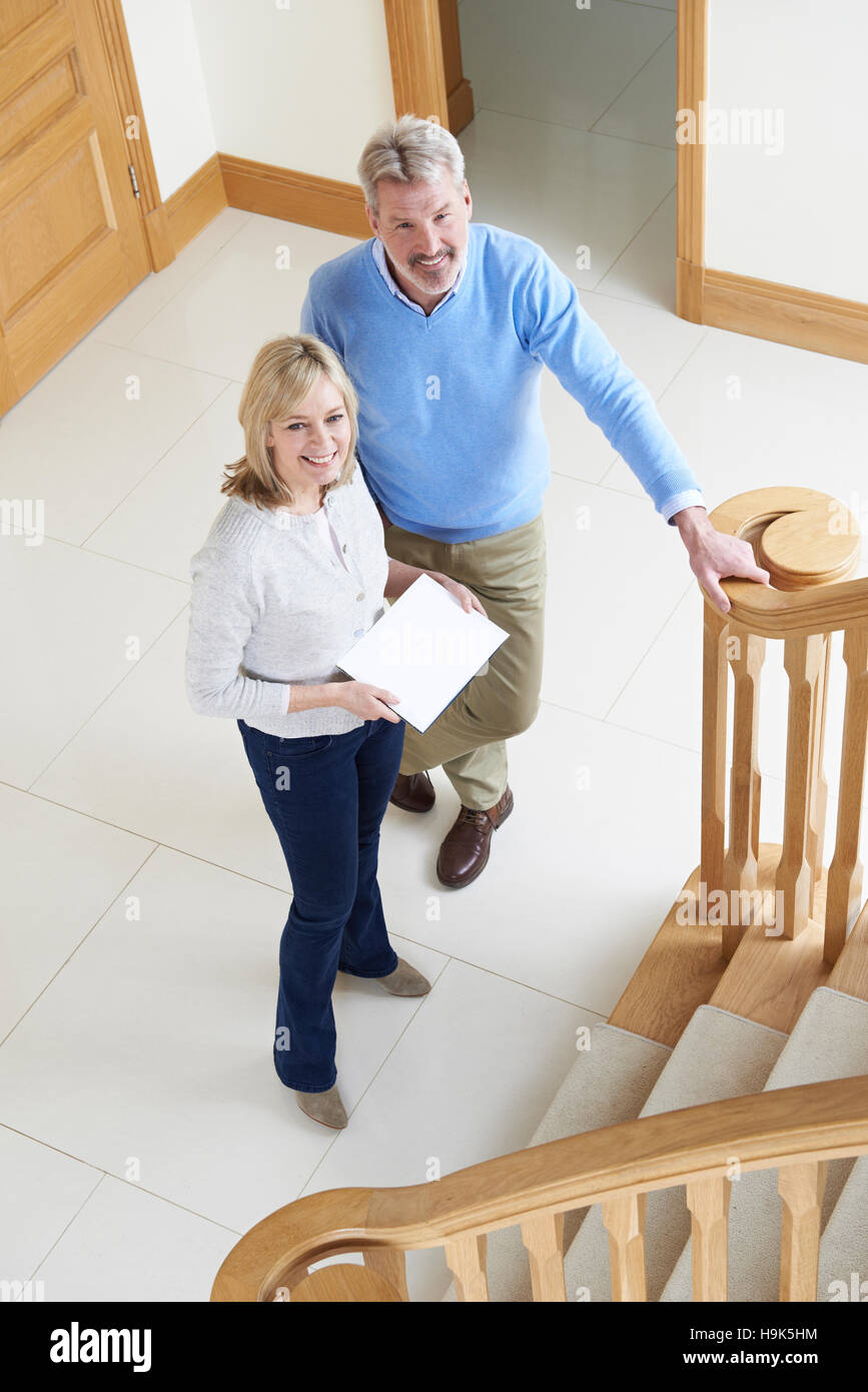 Mature Couple Looking Around House For Sale - Stock Image