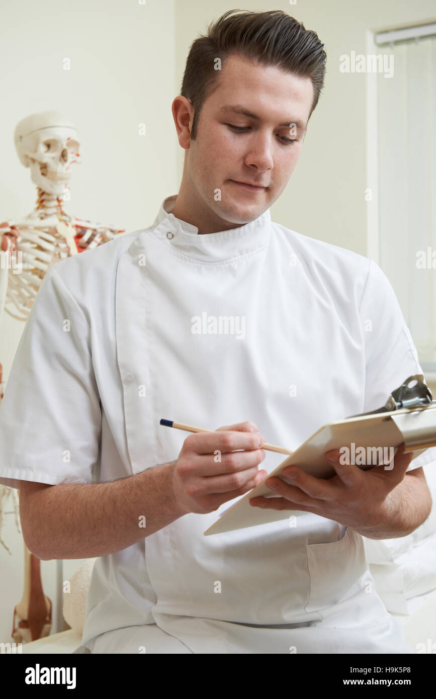 Portrait Of Osteopath In Consulting Room - Stock Image